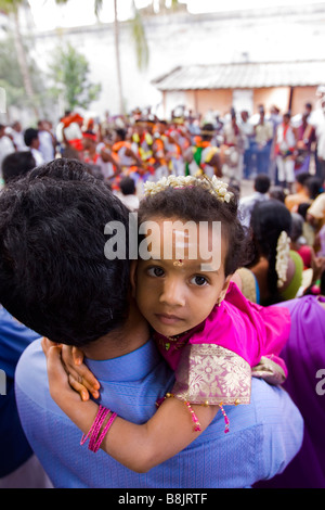 India Tamil Nadu Madurai Thiruchuli village young child in fathers arms - Stock Photo