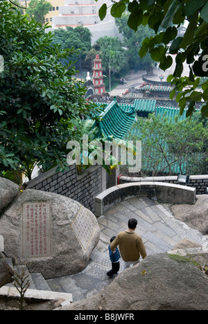 Father and son descending steps at A-Ma Temple, Macau - Stock Photo