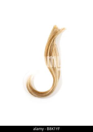 Studio shot of a Lock of Blond hair - Stock Photo
