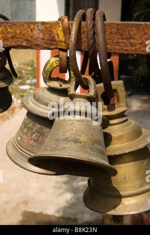 India Tamil Nadu Madurai Thiruchuli Village Hindu Temple cluster of small brass bells - Stock Photo