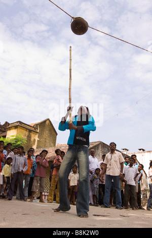 India Tamil Nadu Madurai Thiruchuli Village man playing Pongal harvest festival uriyadi pot breaking game - Stock Photo