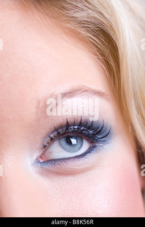 Close up of a beautiful young blond woman looking up