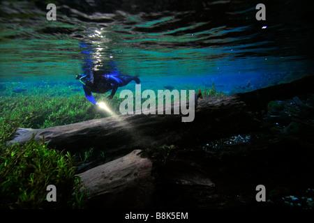 Free diver explores the underwater landscape floating down Baia Bonita River Aquario Natural Bonito Mato Grosso - Stock Photo