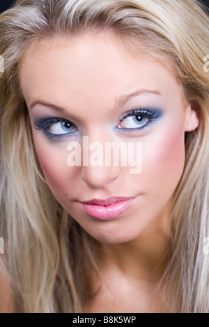Beautiful young woman wearing make up looking up - Stock Photo