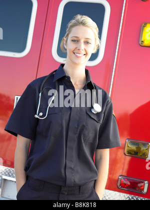 Portrait of paramedic in front of ambulance - Stock Photo