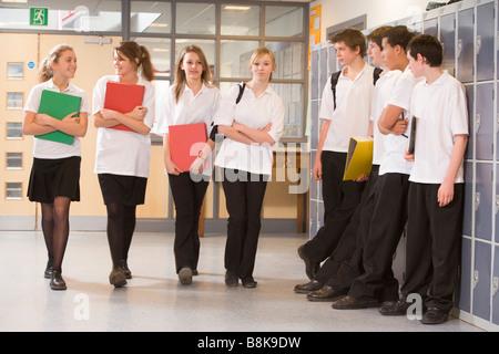 Secondary school students in a school hallway - Stock Photo