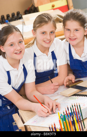 Female students learning woodworking - Stock Photo