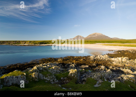 The bay at Inver on the Isle of Jura, looking across a raised beach to the Paps of Jura, Scotland. - Stock Photo