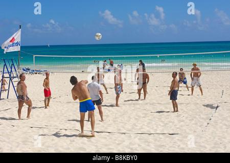 People playing beach volleyball at Maroma beach Caribe Quintana Roo state Mayan Riviera Yucatan Peninsula Mexico - Stock Photo