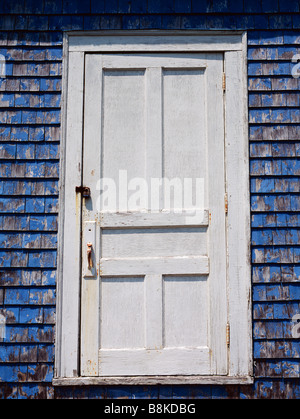 An old white locked door on a Nova Scotian clapperboard house Maritimes Canada - Stock Photo