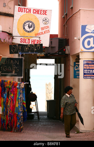 A shopping street in Philipsburg with souvenir shops on the Caribbean isle Saint Martin in the Netherlands Antilles - Stock Photo