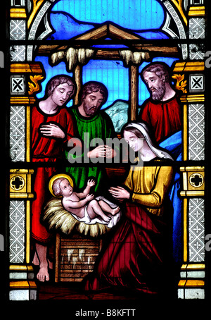 Nativity scene stained glass, St Mary and St Leodegarius Church, Ashby St. Ledgers., Northamptonshire, England, - Stock Photo