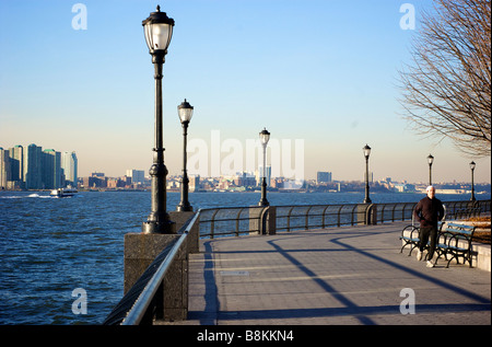 Adult Man Jogging along Hudson River Park in New York City, NY USA - Stock Photo