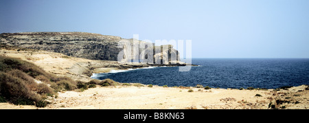 Panoramic picture of fungus rock on Gozo island with view on the beach of Dwejra Bay, Malta. - Stock Photo