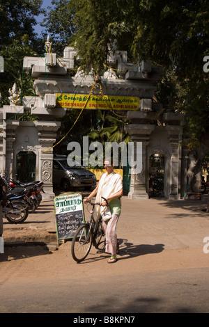 India Tamil Nadu Tiruvannamalai devotee on bicycle at entrance to Sri Seshadri Swamigal ashram - Stock Photo