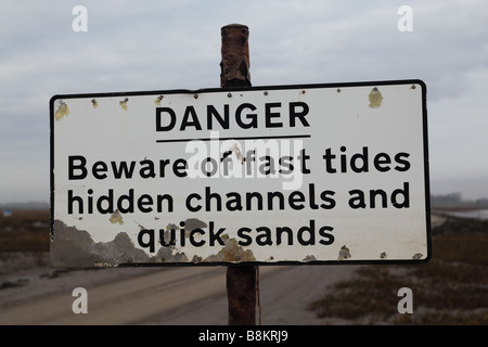 Signpost on the road to Sunderland Point, Morecambe Bay, Lancashire, UK. The road is submerged by the sea at high - Stock Photo
