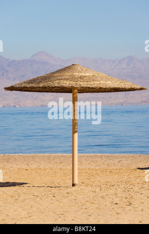 One straw sunshade on a sandy beach on the Red Sea coast. Taba Heights Sinai Egypt Asia - Stock Photo