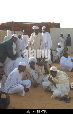 Men waiting the muslim wedding in Banganarti in Old Dongola region at the Nile River Nubia Sudan - Stock Photo