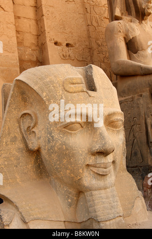 Large stone carved head of Pharaoh Ramses II at entrance to Luxor Temple, 'close up' detail, Egypt - Stock Photo