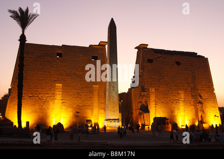 Luxor Temple ruins illuminated at sunset, First Pylon and Obelisk, Thebes, Egypt, [North Africa], UNESCO World Heritage - Stock Photo