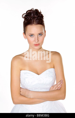 angry bride in white wedding dress - Stock Photo