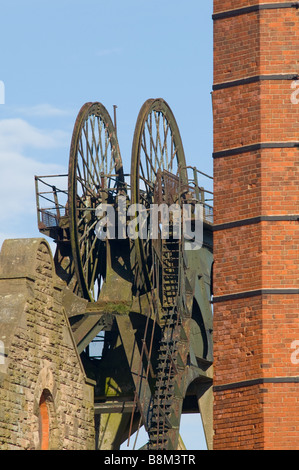 Pleasley colliery disused Winding wheels and brick chimney - Stock Photo