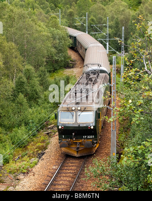 Flaam Railway train, winding its way up the Flaam Valley towards its terminus at Myrdal, Norway. - Stock Photo