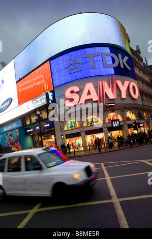 Taxi at Piccadilly Circus in the city of London England - Stock Photo