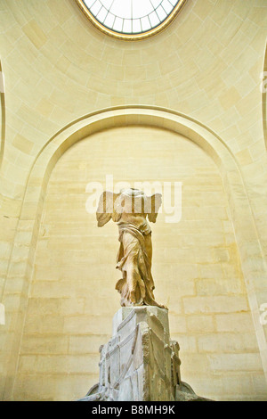 Winged Victory of Samothrace, Hellenistic marble sculpture, 2nd century BC, Musee du Louvre Museum interior Paris - Stock Photo
