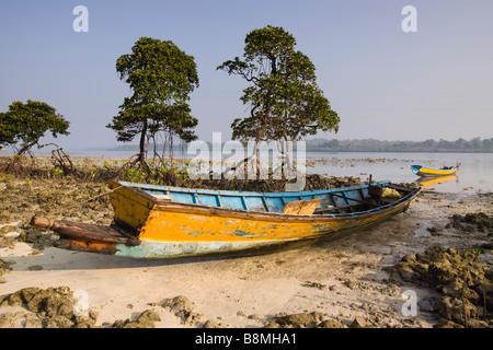 India Andaman and Nicobar Havelock island fishing boat beached on number 2 beach - Stock Photo