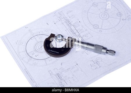 Micrometer measuring precise part on technical drawing. - Stock Photo