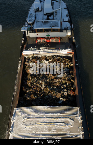 Barge on the river Rhine transporting scrap metal to a recycling facility, Duisburg, Germany. - Stock Photo