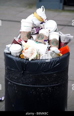 Overflowing litter bin in street, London - Stock Photo