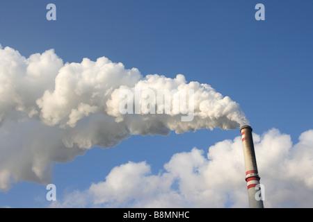 Smoking chimney in coal power plant - Stock Photo