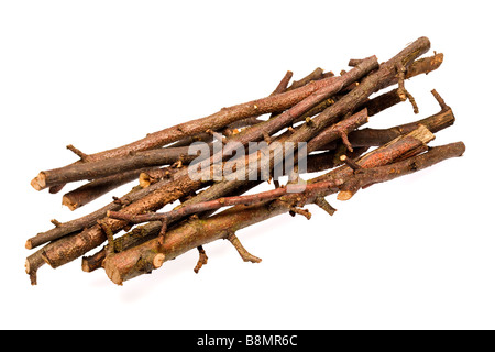 Pile of firewood sticks on white cutout - Stock Photo