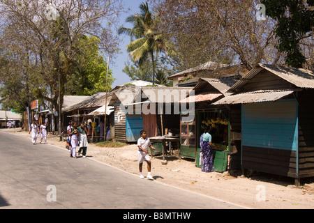 India Andaman and Nicobar Havelock island number 3 village bazaar children walking home after school - Stock Photo