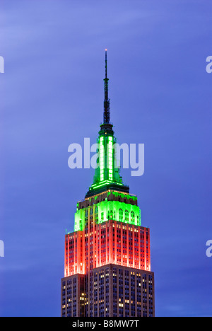 Empire State Building Illuminated at Night for the Christmas Season - Stock Photo