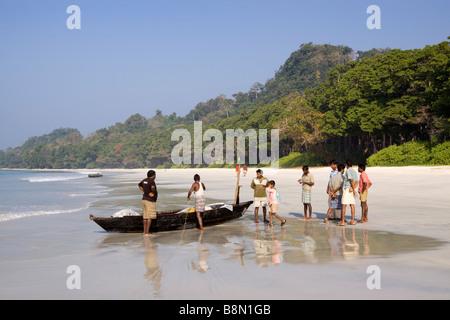 India Andaman and Nicobar Havelock island Radha Nagar beach fishermen preparing to launch fishing boat through the - Stock Photo