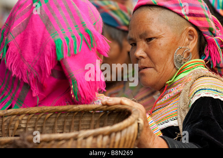 Colorful Flower H'mong tribal women on market day in Bac Ha, Vietnam. The tribal market and socializing ethnic minorities - Stock Photo