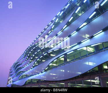 Exterior of car park at twilight dusk night Cardiff Bay Cardiff South Wales UK - Stock Photo