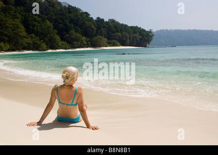India Andaman and Nicobar Havelock island Radha Nagar middle aged woman in bikini on number 7 lagoon beach - Stock Photo