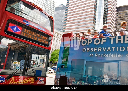Tourists on an open top bus tour of New York city - Stock Photo