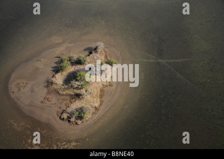 Aerial view of a higher lying island in the tidal flats of the Maputo special reserve - Stock Photo