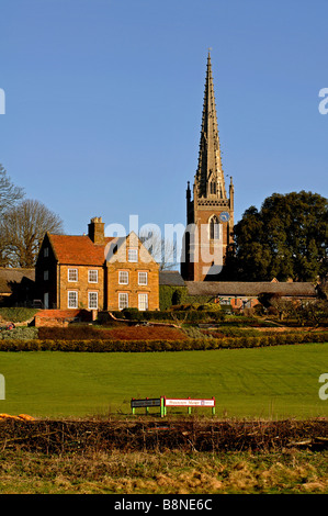 Braunston Manor and All Saints Church, Braunston, Northamptonshire, England, UK - Stock Photo