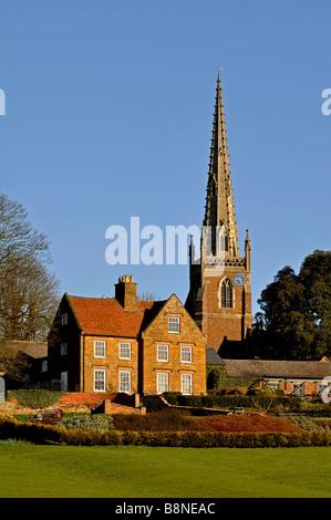 Braunston Manor and All Saints Church, Braunston, Northamptonshire, England, UK - Stock Photo