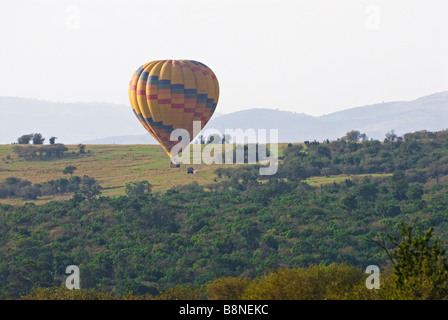 hot-air balloon over Masai Mara National Reserve - Stock Photo