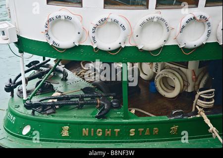 Bow of Star ferry Night Star taking on passengers at Tsim Sha Tsui - Stock Photo