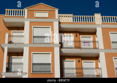 new spanish Apartments Homes With empty Balconies La Marina Spain - Stock Photo