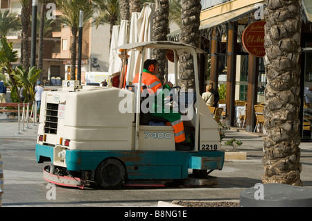Spanish Street Cleaner Cleaning Streets pavement Spain - Stock Photo