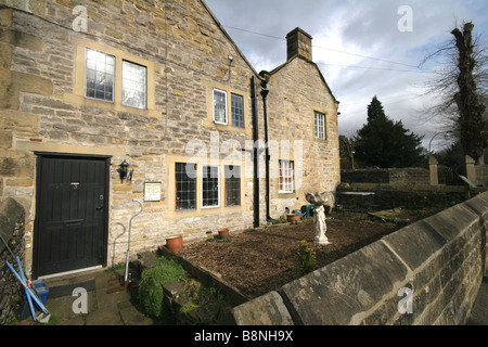 Plague cottages in the black death plague village of Eyam Derbyshire - Stock Photo
